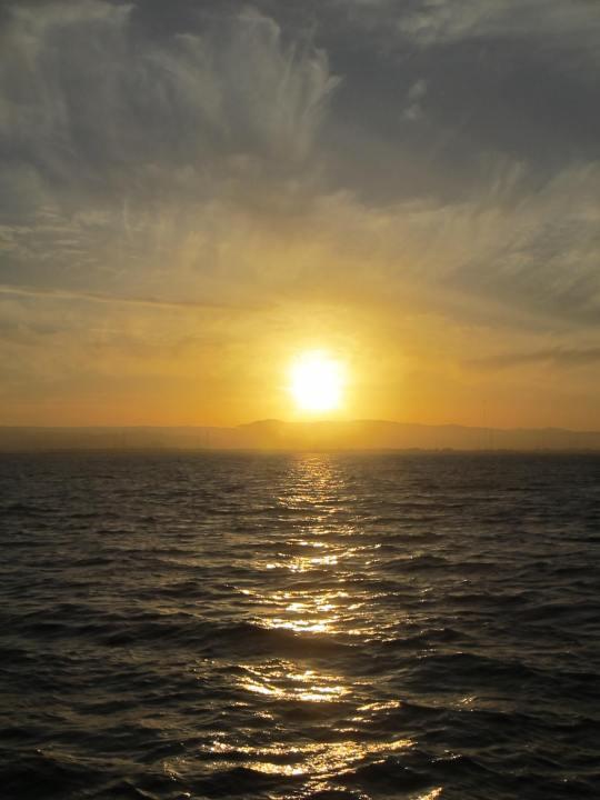 A lemon-drop summer sunset over the San Francisco Bay
